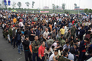 Earthquake refugees line up o receive aid at a camp in the sports stadium in Mianyang, China