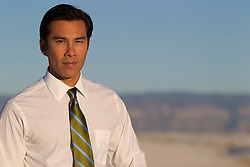 handsome Asian American man in a shirt and tie outdoors in New Mexico