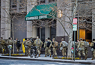 Troops in Washington DC on January 20, 2021 walking by Stabuck Coffe .  after Biden's inuguration.