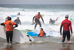 © Licensed to London News Pictures. 31/07/2020. Newquay, UK. Beginner surfers on Fistral Beach, Cornwall, on a very hot day in the southwest. Parts of the country are expected to have the hottest day of the year so far. Photo credit : Tom Nicholson/LNP
