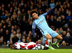 Leroy Sane of Manchester City avoids a tackle from Mame Biram Diouf of Stoke City - Mandatory by-line: Matt McNulty/JMP - 08/03/2017 - FOOTBALL - Etihad Stadium - Manchester, England - Manchester City v Stoke City - Premier League