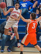 leaping to save the ball, RV's Aaliyah Paxton pass around Cherokee's Shaye McGoey during the South Jersey Invitational girls basketball tournement at Eastern High School in Voorhees, NJ, Saturday, February 14, 2015.  Photo by Bryan Woolston / @woolstonphoto.