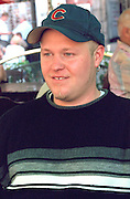 Man age 23 in outdoor sidewalk cafe.  Warsaw Poland