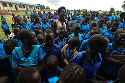 July 13, 2017 - Juba, Jubek, South Sudan - Supermodel Ajah Kiir, the South Sudanese 2016 Miss World representative, addresses a group of girls, teaching them how to use hygiene pads in the Gumbo Basic Primary School on the outskirts of the South Sudanese capital of Juba. Common practices are as exotic as digging a hole and sitting there for four days to using dung of cows, often with severe health consequences. as fistula and severe infections. Kiir aims to reach girls in all the public schools in Juba, many of which have not been funded in several years in a country where civil war and deep corruption continues, draining budgets, displacing millions and leaving millions more on the edge of starvation. (Credit Image: © Miguel Juarez Lugo via ZUMA Wire)