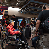Lawrence Talamante, 94, is surrounded by family as he is interviewed at the Albuquerque International Sunport in Albuquerque Jun. 07.