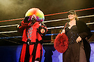 """""""Tommy The Clown"""" with Debbie Allen of """"Fame"""" the TV show..Battlezone 2005 held at the Great Western Forum in Inglewood, CA. Krumpers and Clown dancers from South Central LA showcase their dancing skills in a yearly competition. Tommy Johnson, aka """"Tommy the Clown"""" started the Clown dance and Krumping movement in South Central LA as a real alternative to gangs and crime. The high energy Krumping and Clown dancing are hip hop based with African tribal dancing tributes. Face paint is often worn to distinguish the dancers unique dance styles, most are clown like with graffiti accents. The dance movement was made popular by the recent documentary """"Rize"""" by photographer David LaChappelle which featured """"Tommy The Clown"""".."""