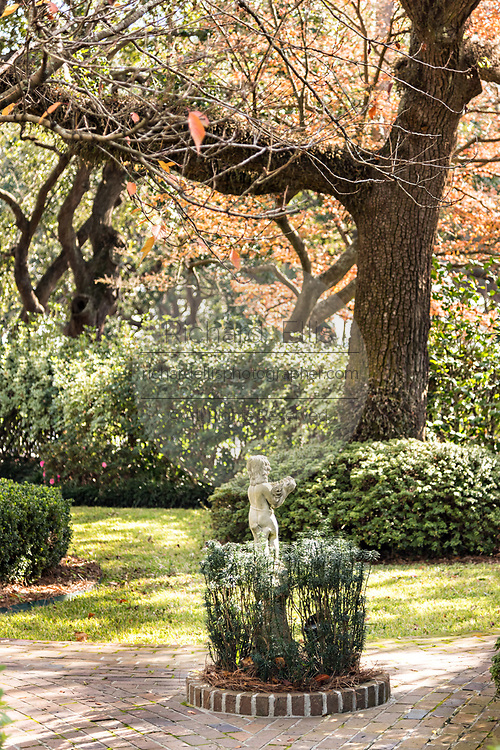 A statue decorates the garden of the Meeting Street Inn on Meeting Street in Charleston, SC.