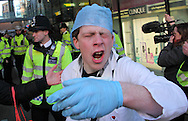 """Moments after a UK Uncut protestor had been """"pepper-sprayed"""" by a Policeman outside Boots on Oxford Street."""