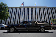Kristen Affrime, of Cherry Hill, drives a hearse past Governor Phil Murphy's office in Trenton as teachers and community members from the group NJ21United, which bills themselves as a coalition of educators and community members who care about public education and public workers in New Jersey, participate in a socially distanced motor march Aug. 3, 2020, to advocate for holding off the reopening of schools until it's safe for everyone. (Photo by Matt Smith)