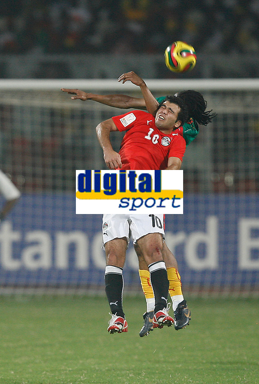 Photo: Steve Bond/Richard Lane Photography.<br />Egypt v Cameroun. Africa Cup of Nations. 22/01/2008. Emad Meteeb (front) and Rigobert Song (back) in an aeriel challange