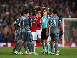 Referee Ovidiu Alin Hategan gestures after showing Manchester United's Eric Bailly (centre left) a red card during the UEFA Europa League, Second Leg match at Old Trafford, Manchester.