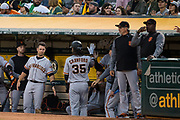 The San Francisco Giants celebrate a run scored by San Francisco Giants shortstop Brandon Crawford (35) against the Oakland Athletics at Oakland Coliseum in Oakland, California, on July 31, 2017. (Stan Olszewski/Special to S.F. Examiner)