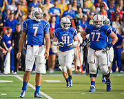 Dec 1, 2012; Tulsa, Ok, USA; Tulsa Hurricanes quarterback Cody Green (7) halfback Cody Wilson (41) and offensive guard Jake Alexander (77) look to the sidelines during a game against the University of Central Florida Knights at Skelly Field at H.A. Chapman Stadium. Tulsa defeated UCF 33-27 in overtime to win the CUSA Championship. Mandatory Credit: Beth Hall-USA TODAY Sports