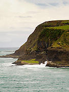 Headlands and waves to the west of Curio Bay, South Island, New Zealand, on a grey day...