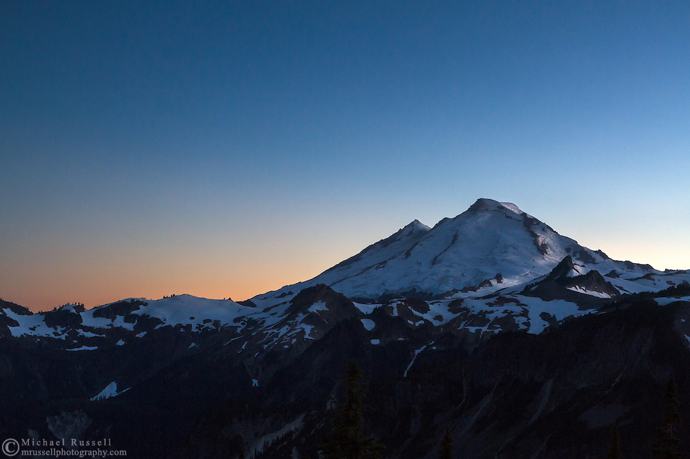 Last glow of sunset light on Mount Baker/Kulshan from Artist Point at the Mount Baker-Snoqualmie National Forest in Washington State, USA.