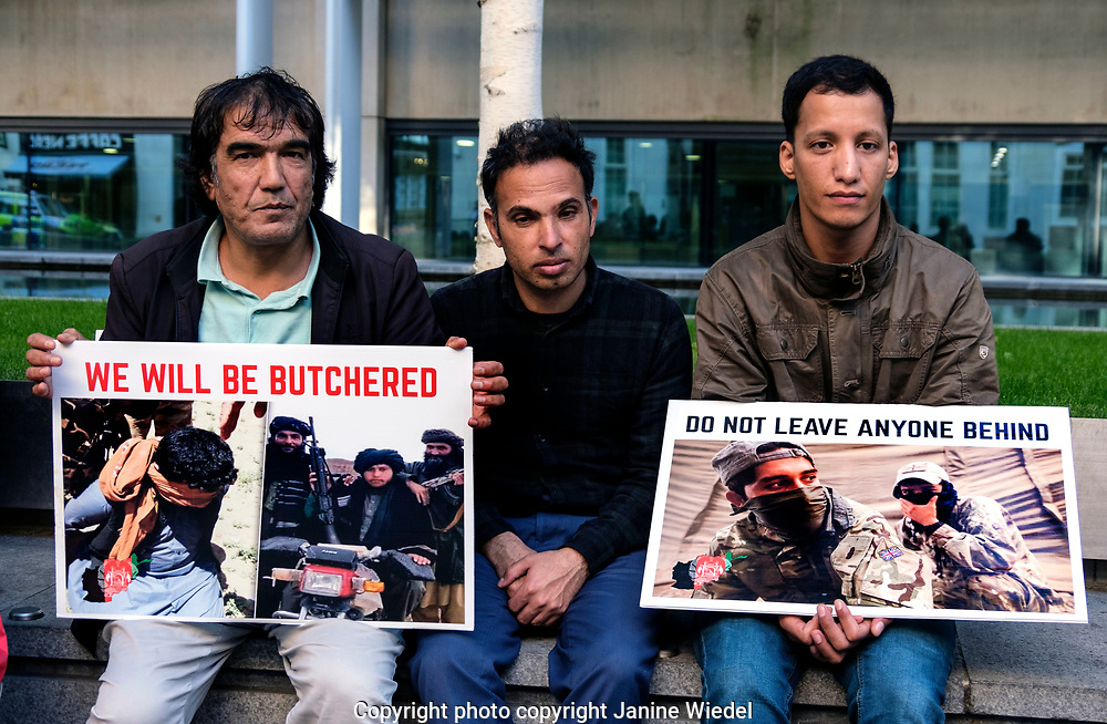 Former Afghan interpreters who worked with UK army protest outside the Home Office . They ask the UK government for protection and safe passage for their families still in Afghanistan and in danger of being killed by the Taliba.