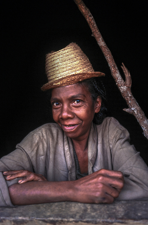Portrait of a local woman in her mud home in the Fianarantsua Highlands, Madagascar