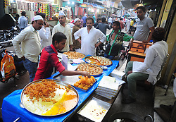 May 28, 2017 - Allahabad, Uttar Pradesh, India - Indian Muslims eat their eftar as they break their day long fast on the first day of Ramadan month at Jama Moshque. (Credit Image: © Prabhat Kumar Verma/Pacific Press via ZUMA Wire)