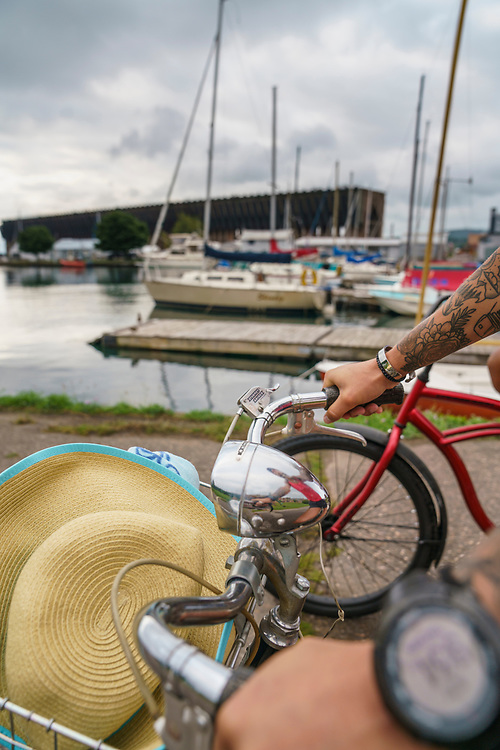 Riding bikes along the waterfront near the old ore dock of downtown Marquette, Michigan.