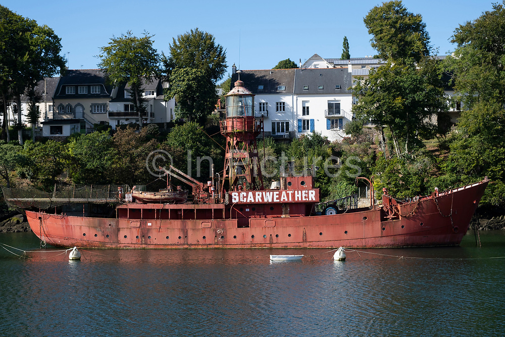 An old lighthouse ship Scarweather moosed up in harbour on 20th September 2021 in Douarnenez, Brittany, France. Douarnenez has three habours and is a commune in the French department of Finistere. It is located at the mouth of the Pouldavid River, an estuary on the southern shore of Douarnenez Bay in the Atlantic Ocean. Brittany is a peninsula, historical county, and cultural area in the west of France, covering the western part of what was known as Armorica during the period of Roman occupation. It became an independent kingdom and then a duchy before being united with the Kingdom of France in 1532 as a province governed as a separate nation under the crown.