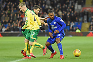 Cardiff City midfielder Junior Hoilett (33) battles for possession with Norwich City midfielder Wesley Hoolahan (14) and Norwich City midfielder James Maddison (23) 0-0  during the EFL Sky Bet Championship match between Cardiff City and Norwich City at the Cardiff City Stadium, Cardiff, Wales on 1 December 2017. Photo by Alan Franklin.