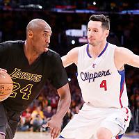 31 October 2014: Los Angeles Lakers guard Kobe Bryant (24) drives past Los Angeles Clippers guard J.J. Redick (4) during the Los Angeles Clippers 118-111 victory over the Los Angeles Lakers, at the Staples Center, Los Angeles, California, USA.