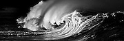 Powerful shorebreak wave on Oahu's North Shore, Hawaii. Black and white photo
