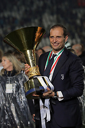 May 19, 2019 - Turin, Turin, Italy - head coach of Juventus FC Massimiliano Allegri celebrate with the trophy after winning the Serie A Championship at the end of the serie A match between Juventus FC and Atalanta BC at Allianz Stadium on May 19, 2019 in Turin, Italy. (Credit Image: © Giuseppe Cottini/NurPhoto via ZUMA Press)