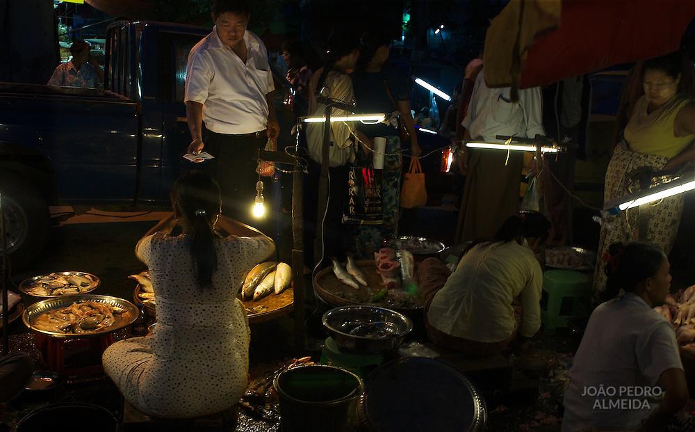Night market at one of Yangon's main avenues
