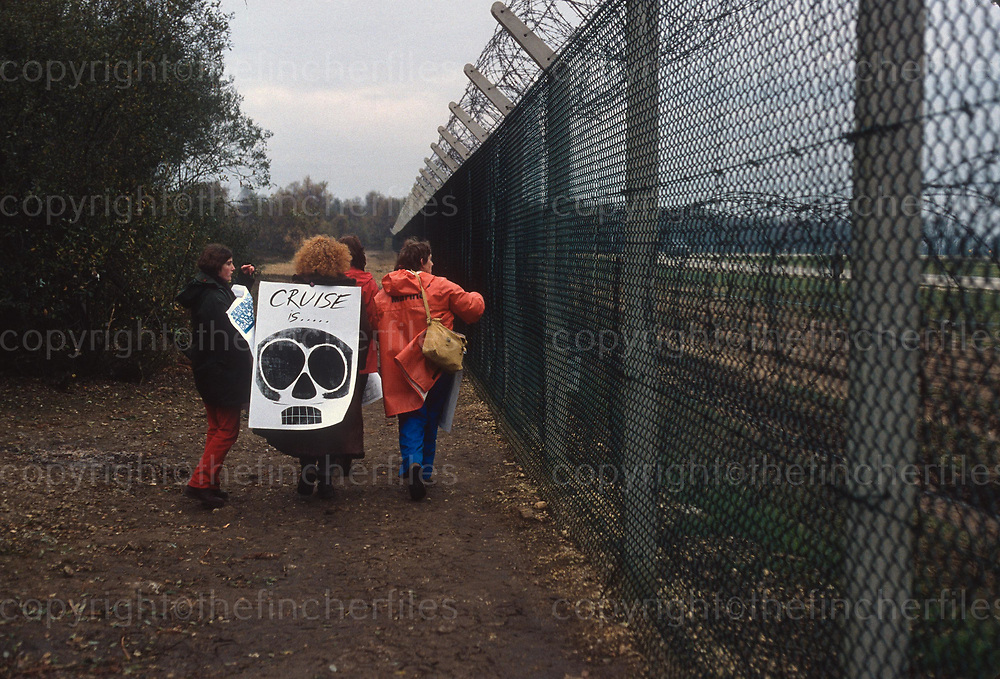 Women protestors around the perimeter fence of the Greenham Common Airbase during the protests against nuclear weapons in 1982. Photograph by Jayne Fincher