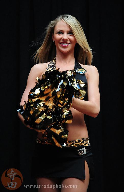 January 28, 2011; Honolulu, HI, USA; Jacksonville Jaguars cheerleader Kelli Schaible performs during a 2011 Pro Bowl cheerleader appearance at the Ala Moana Center. Mandatory Credit: Kyle Terada-Terada Photo