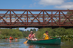 North America, United States, Washington, Bellevue, woman and boy (age 9) kayaking under bridge in Mercer Slough Nature Park.  MR