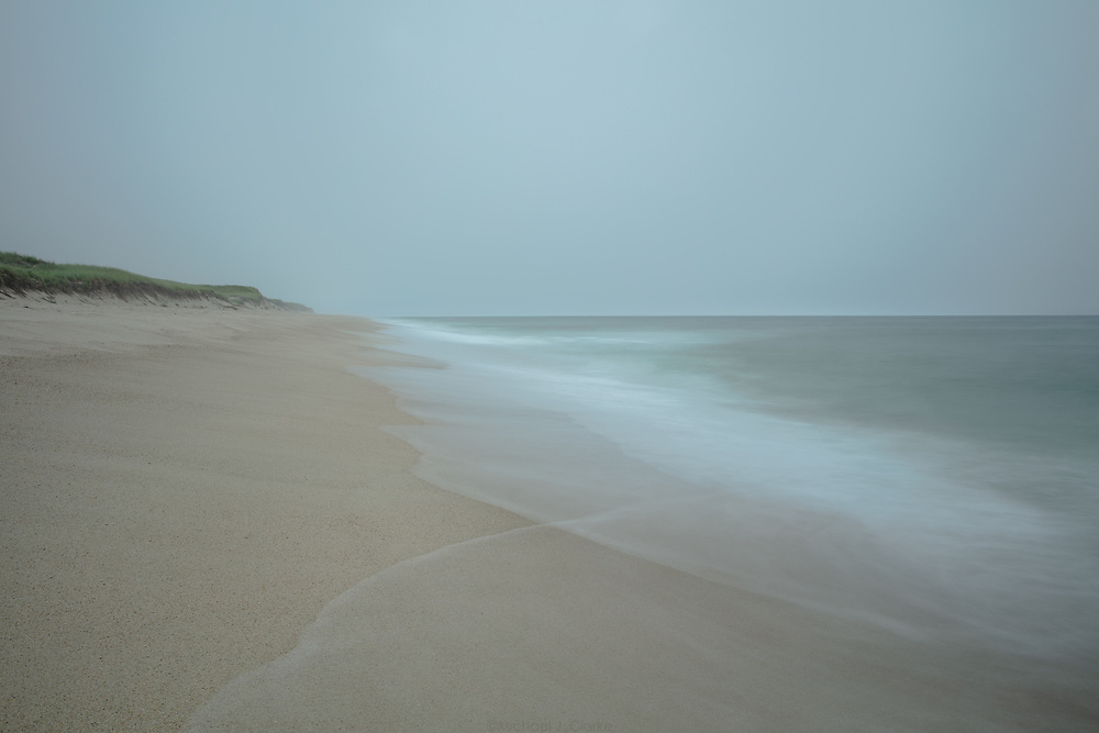 Waves reaching the sandy shores of Miacomet Beach in Nantucket, MA.