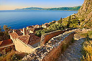 Arial view of Monemvasia (  ) Byzantine Island catsle town with acropolis on the plateau.   Peloponnese, Greece ..<br /> <br /> Visit our GREEK HISTORIC PLACES PHOTO COLLECTIONS for more photos to download or buy as wall art prints https://funkystock.photoshelter.com/gallery-collection/Pictures-Images-of-Greece-Photos-of-Greek-Historic-Landmark-Sites/C0000w6e8OkknEb8 <br /> .<br /> <br /> Visit our MEDIEVAL PHOTO COLLECTIONS for more   photos  to download or buy as prints https://funkystock.photoshelter.com/gallery-collection/Medieval-Middle-Ages-Historic-Places-Arcaeological-Sites-Pictures-Images-of/C0000B5ZA54_WD0s