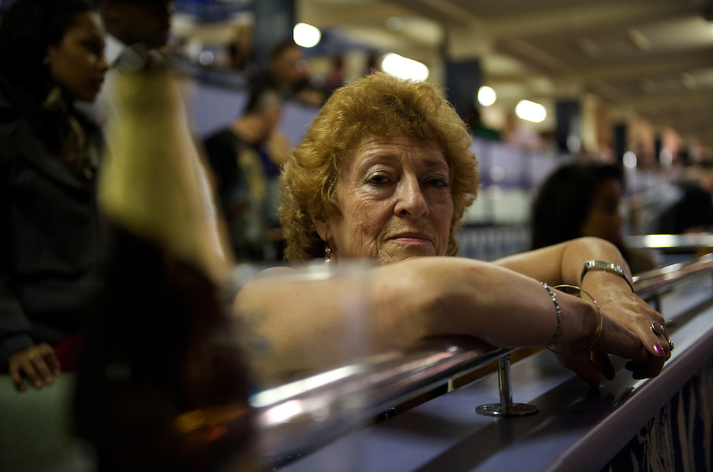 Walthamstow, England.  August 16, 2008.  A woman soaks in the atmosphere during greyhound racing at Walthamstow Stadium Saturday night.  After a 75 year history the dog racing stadium closed as a result of diminishing profits and poor attendance.  Record crowds flocked to take in the festivites one last time...