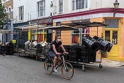 Licensed to London News Pictures. 27/08/202. London, UK. Steel drums on trailers line the street in All Saints Road in Notting Hill, West London today as the 2021 Notting Hill Carnival is cancelled for another year as a result of the ongoing Covid-19 pandemic. However, there is expected to be alternative events going on for Londoners and tourists this weekend in W11 with steel bands and Brazilian bands making an appearance at the Panorama event a celebration of carnival culture. Photo credit: Alex Lentati/LNP