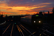 Sunset at Parsons Green tube station, South West London. A District line train going to Edgware road station.