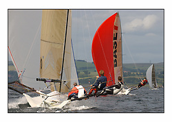 The 2004 Skiff Nationals at Largs held by the SSI.<br /> <br /> Hermes helmed by Grant Rollerson with Base 1 helmed by Rob Dulson ahead.<br /> <br /> Marc Turner / PFM Pictures