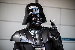 © Licensed to London News Pictures . 30/07/2017 . Manchester , UK . Darth Vader takes a cigarette break outside the venue . Cosplayers, families and guests at Comic Con at the Manchester Central Convention Centre . Photo credit : Joel Goodman/LNP