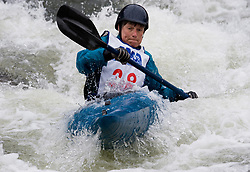 Catherine McCredie of Chesterfield, Missouri races in the K1 women's master plastic class during the slalom course of the 42nd Annual Missouri Whitewater Championships. McCredie placed third place in the class. The Missouri Whitewater Championships, held on the St. Francis River at the Millstream Gardens Conservation Area, is the oldest regional slalom race in the United States.