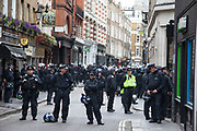 London, UK. Tuesday 11th June 2013. Protesters demonstrate against the upcoming G8 summit in central London, UK. Police in riot gear cordoned off a part of Beak St. in Soho where activists who were planning a big protest were being surrounded.