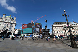 © Licensed to London News Pictures. 16/03/2020. London, UK. Piccadilly Circus appears quiet this afternoon . New cases of the COVID-19 strain of Coronavirus are being reported daily as the government outlines it's plans for controlling the outbreak. Photo credit: George Cracknell Wright/LNP