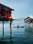 Cooking over fire. Evening around bamboo stilt houses off Bodgaya island.