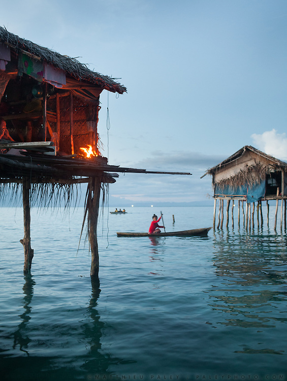 Cooking over fire. Evening around bamboo stilt houses off Bodgaya island.
