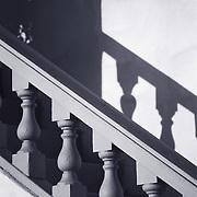 1950's era stair rails leading upwards in old apartment building.