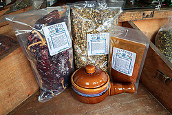 Display with Pendery's famous Chiltomaline spice blend for chiles invented in the 1800s, along with Green Chile Flakes and New Mexico Chiles, Pendery's World of Chiles & Spices retail store, Fort Worth, Texas USA.