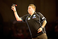 Michael Smith in action against Steve Beaton during the World Darts Championship at Alexandra Palace, London, United Kingdom on 27 December 2015. Photo by Shane Healey.