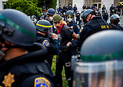 A protester is detained by CHP officers on the East side of the Capitol on Sunday, May 31, 2020. Protesters reacted on Saturday to the death of Minneapolis man George Floyd.