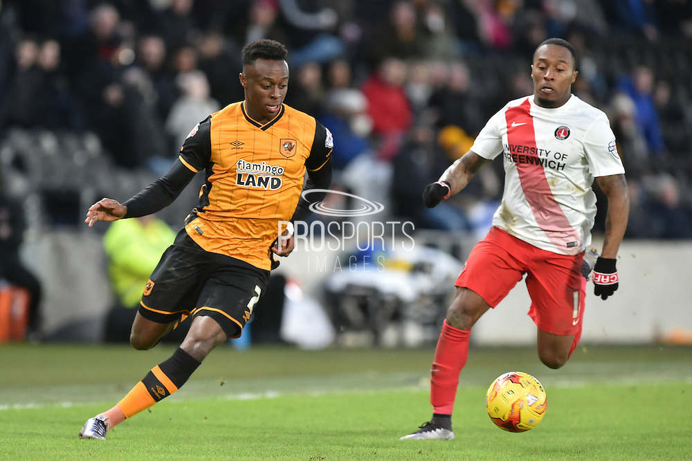 Hull City midfielder Moses Odubajo (2) and Callum Harriott of Charlton Athletic  during the Sky Bet Championship match between Hull City and Charlton Athletic at the KC Stadium, Kingston upon Hull, England on 16 January 2016. Photo by Ian Lyall.