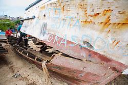 Dismantling Boat With Chain Saw, San Cristóbal